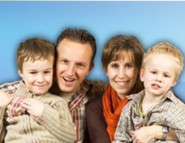 Smiling family with two kids. Informations about child allowance.