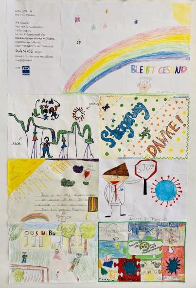 Kinder malten ihre schönsten Eindrücke - Übergabe einer Collage an Dr. Frank Pisani - Onlineteam